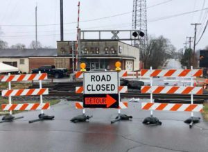 Road closed sign, blocking the roadway like plaque blocks arteries.